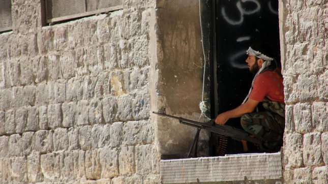 A Syrian rebel fighter stands his position in the Old City of Aleppo, Syria, September 12, 2012. UPI/Ahmad Deeb