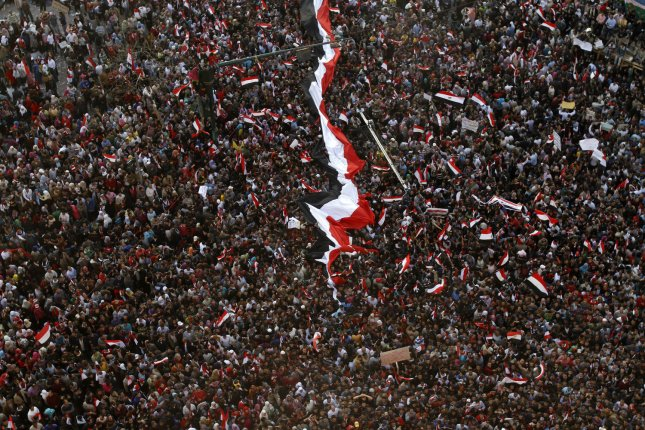 Egyptians celebrate the one week anniversary of the ousting of former President Hosni Mubarak in Tahrir Square, Cairo, Egypt, February 18, 2011. Thousands of Egyptians packed Tahrir Square for a day of prayer and celebration to mark the fall of longtime leader Hosni Mubarak. UPI