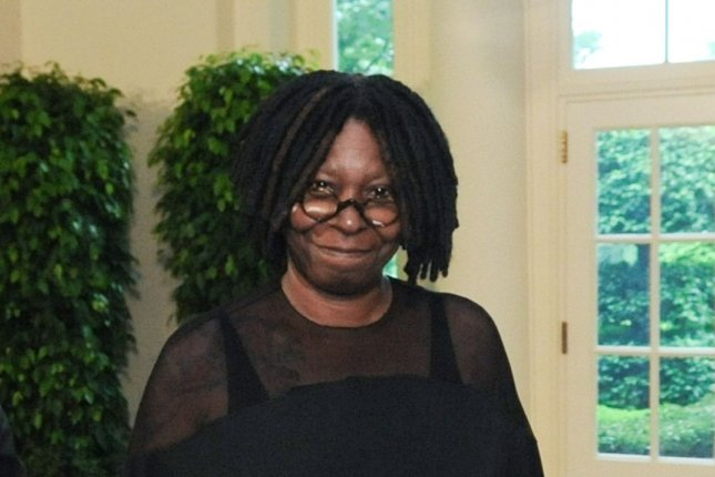 Whoopi Goldberg (R) and Thomas Leonardis arrive for the State Dinner with U.S. President Barack Obama, First Lady Michelle Obama, Mexican President Felipe Calderon and his wife Margarita Zavala at the White House in Washington on May 19, 2010. UPI/Alexis C. Glenn