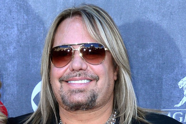 Vince Neil attends the 49th annual Academy of Country Music Awards on April 6, 2014. Neil is facing a misdemeanor battery charge stemming from a fight outside a Las Vegas hotel in April. File Photo by Jim Ruymen/UPI