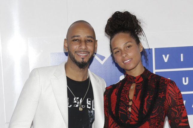 Swizz Beatz and Alicia Keys arrive on the red carpet at the 2016 MTV Video Music Awards on August 28, 2016. Keys recently appeared on Today to talk about her makeup free movement, which inspired three of the show's anchors to remove their own makeup on camera. File Photo by John Angelillo/UPI
