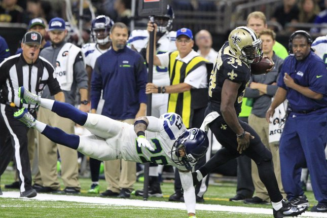 New Orleans Saints running back Tim Hightower (34) sheds Seattle Seahawks cornerback Richard Sherman (25) on his way to a 28 yard gain at the Mercedes-Benz Superdome in New Orleans October 30, 2016. Photo by AJ Sisco/UPI