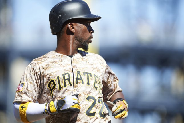 Pittsburgh Pirates center fielder Andrew McCutchen (22) scores while watching a double to left field from David Freese in the eight inning of the 7-4 loss against Detroit Tigers at PNC Park in Pittsburgh on April 14, 2016. Photo by Shelley Lipton/UPI