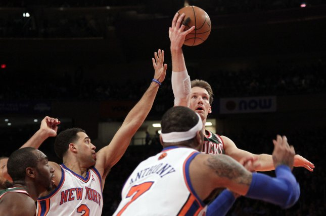 Milwaukee Bucks Mike Dunleavy shoots over New York Knicks Carmelo Anthony in the second quarter at Madison Square Garden in New York City on March 26, 2012. File Photo by John Angelillo/UPI