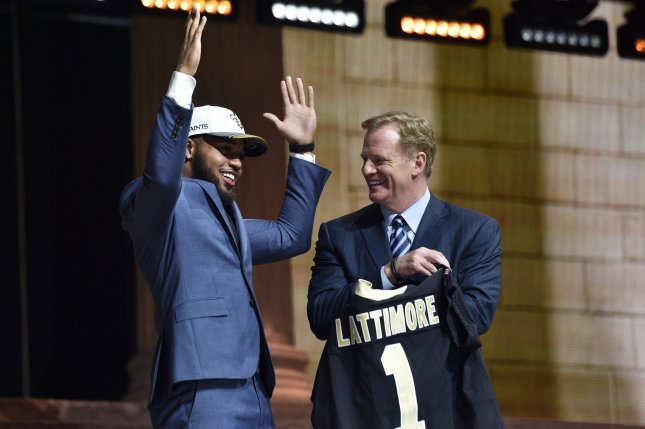 Marshon Lattimore poses for photographs with NFL Commissioner Roger Goodell after being selected by the New Orleans Saints as the 11th overall pick in the 2017 NFL Draft at the NFL Draft Theater in Philadelphia, PA on April 27, 2017. The 82nd NFL Draft returned to Philadelphia for the first time in more than 50 years and runs from April 27-29. Photo by Derik Hamilton/UPI