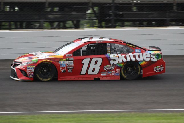 Kyle Busch blasts through the north short chute during the Brickyard 400 in Indianapolis. Photo by Bill Coons/UPI