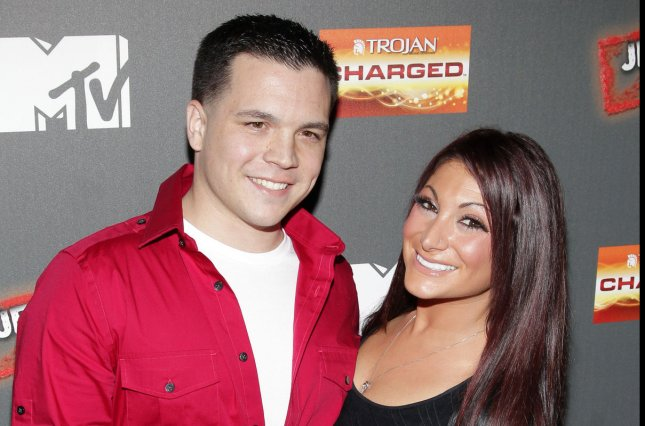 Deena Cortese (R) and Christopher Buckner (L) got married on Saturday. File Photo by John Angelillo/UPI