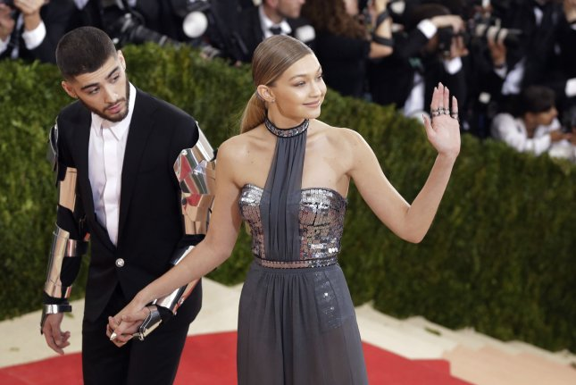 Gigi Hadid (R), pictured with Zayn Malik, shared a picture with the singer in bed Tuesday. File Photo by John Angelillo/UPI