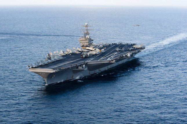 The Nimitz-class aircraft carrier USS Abraham Lincoln led its strike group in exercises with the Romanian military this week before heading for the Strait of Hormuz. File Photo by Will Tyndall/U.S. Navy/UPI