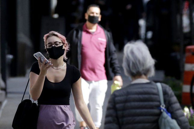 A new poll found more than 90% of people in the United States are wearing masks to prevent spread of COVID-19, like the people pictured on a Madison Avenue Sidewalk in New York City September. Photo by John Angelillo/UPI