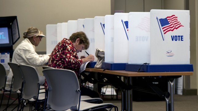 Florida voters in Jupiter, Florida, fill out their ballots for the 2012 Election at the Jupiter public library on November 6, 2012. With lighter than normal turnout on election day, most Florida voters cast their ballots during early voting. The polls in Florida are open from 7A.M. to 7P.M. UPI/Gary I Rothstein