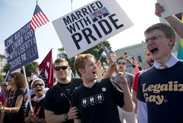 Gay rights supporters rally in front of the Supreme Court in Washington, D.C on, June 26, 2013. The Supreme Court is expected to announce its ruling on California's Proposition 8 ban on same-sex marriage and the federal Defense of Marriage Act. UPI/Kevin Dietsch