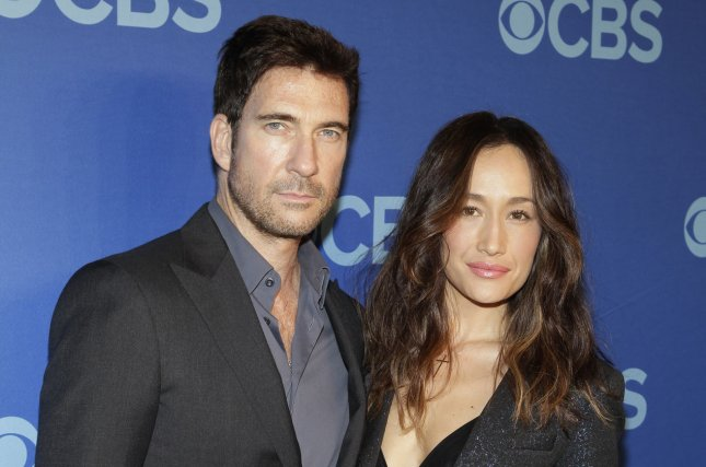 Maggie Q (R) and fiancé Dylan McDermott. File photo by John Angelillo/UPI