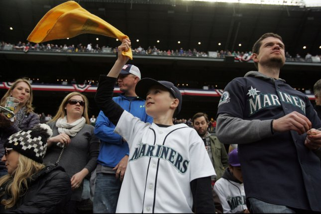 Nine-year-old Peyton Sprangers waves a Felix Hernandez towel during the season home opener against the Los Angeles Angles April 6, 2015 at Safeco Field in Seattle. The Mariners beat the Angels 4-1. Photo by Jim Bryant/UPI
