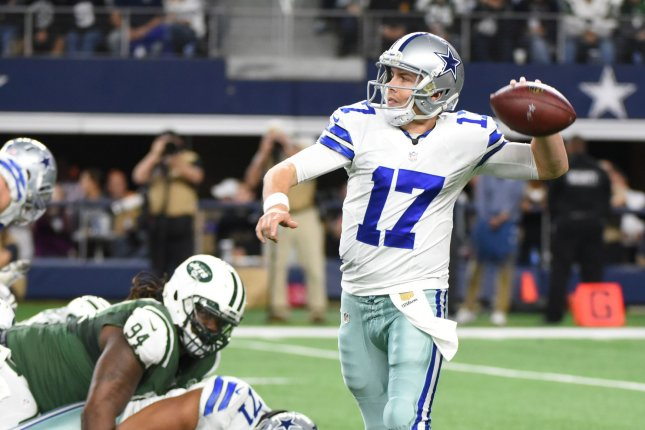 Dallas Cowboys backup quaterback Kellen Moore looks to throw against the New York Jets during the first half at AT&T Stadium on December 18, 2015 in Arlington, Texas. Photo by Ian Halperin/UPI