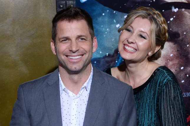 Director Zack Snyder (L) and producer Deborah Snyder attend the premiere of 300: Rise of an Empire on March 4, 2014. The Snyders are stepping down from Justice League and taking a break following the sudden death of their daughter. File Photo by Jim Ruymen/UPI