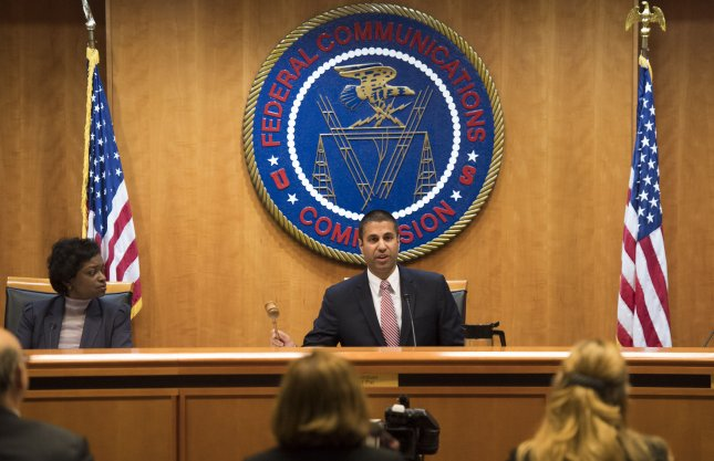 Federal Communications Commission Chairman Ajit Pai (C) speaks on December 14 in Washington, D.C. On Thursday, the FCC proposed a $13.4 million fine against Sinclair Broadcasting Group. Photo by Kevin Dietsch/UPI