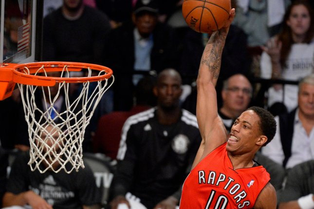Toronto Raptors guard DeMar DeRozan (10) dunks in the fourth quarter against the Brooklyn Nets in Game 6 of the Eastern Conference Quarterfinals at Barclays Center in New York City on May 2, 2014. File photo by Rich Kane/UPI