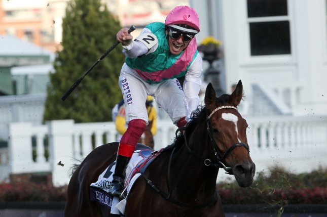 Jockey Lanfranco Dettori celebrates after riding Enable to victory in the 2018 Breeders' Cup Turf Championship race at Churchill Downs on November 3 in Louisville, Kentucky. Photo by John Sommers II/UPI