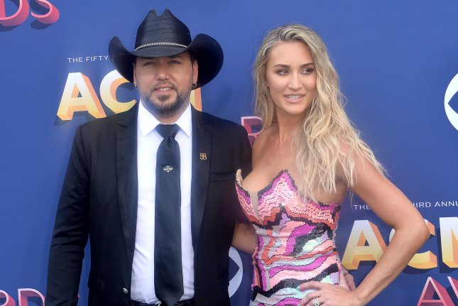 Jason Aldean (L) and Brittany Aldean will name their baby girl Navy Rome Williams. File Photo by Jim Ruymen/UPI