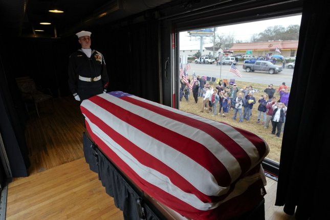 The flag-draped casket of former President George H.W. Bush passes through Magnolia, Texas, Thursday, December 6, 2018, along the route from Spring to College Station, Texas. Pool photo by David J. Phillip/UPI