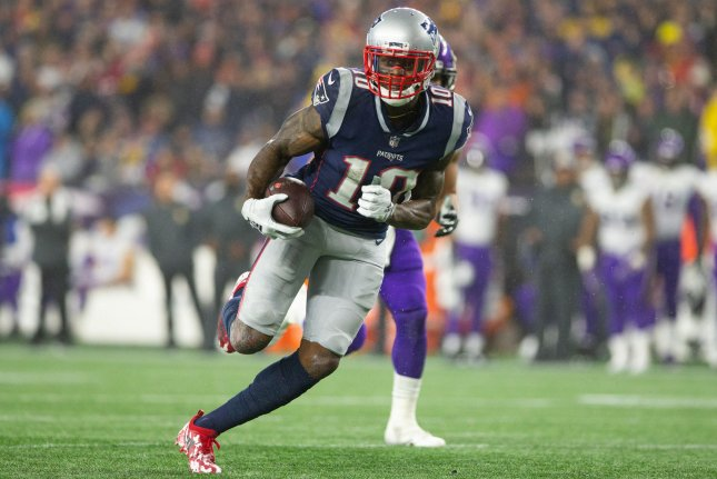 New England Patriots wide receiver Josh Gordon (10) charges toward the end zone on a 24-yard touchdown reception in the third quarter against the Minnesota Vikings on December 2, 2018 at Gillette Stadium in Foxborough, Massachusetts. Photo by Matthew Healey/UPI