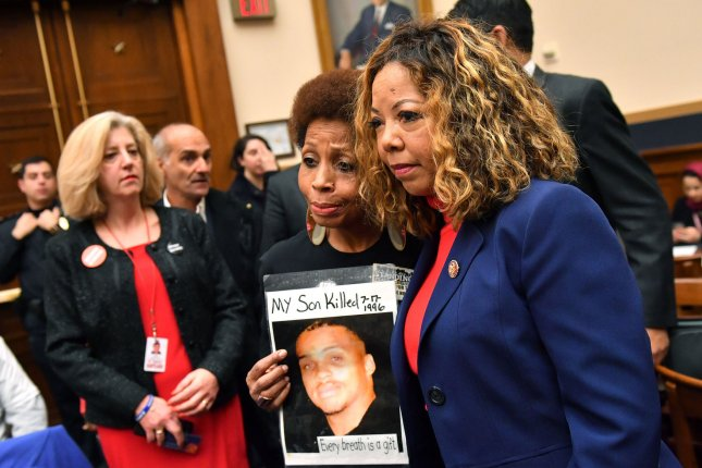 Georgia Rep. Lucy McBath greets Mattie Scott, whose son George was killed in a shooting in 1996, before a House judiciary committee hearing on gun violence on February 6. Photo by Kevin Dietsch/UPI