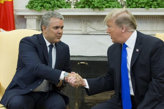 Then-U.S. President Donald Trump (R) meets with the President of Colombia Ivan Duque in the Oval Office of the White House in 2019. File Pool Photo by Michael Reynolds/UPI