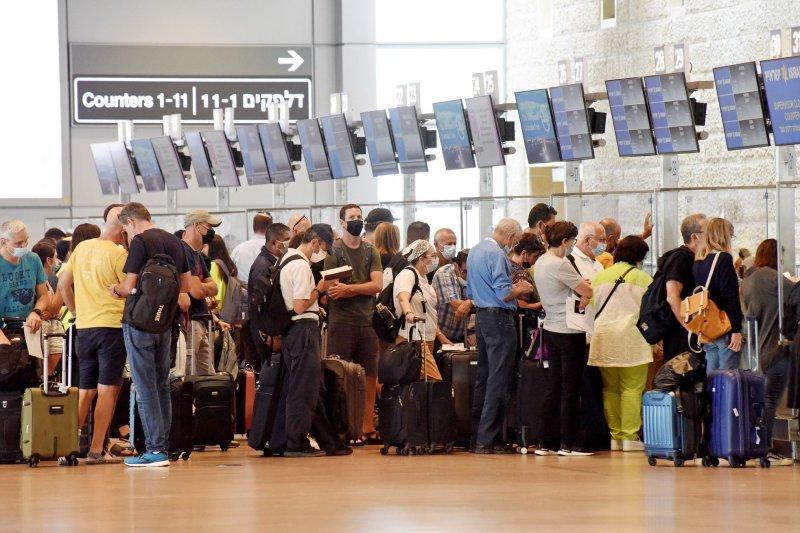 Travelers are seen at Ben Gurion International Airport near Tel Aviv, Israel, on June 23. Photo by Debbie Hill/UPI
