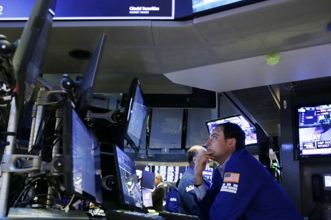 The Dow Jones Industrial Average gained 71 points Monday, spurred largely by rising bank and energy stocks. Photo by John Angelillo/UPI