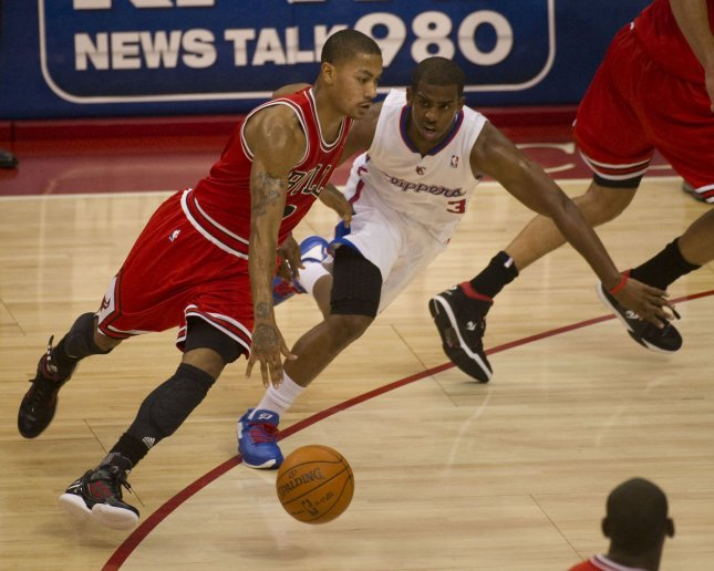 Chicago's Derrick Rose drives by the Los Angeles Clippers' Chris Paul in a Dec. 30, 2011, game. UPI/Jon SooHoo