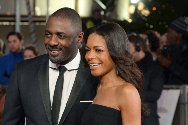English actor Idris Elba and English actress Naomie Harris attend the Royal film performance of 'Mandela: Long Walk to Freedom' at The Odeon Leicester Square in London on December 5 2013. UPI/Paul Treadway