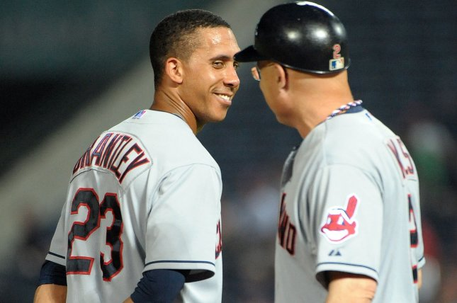 Cleveland Indians' Michael Brantley (23) talks to third base coach Brad Mills during an Atlanta Braves pitching change in the seventh inning at Turner Field in Atlanta, August 28, 2013. UPI/David Tulis