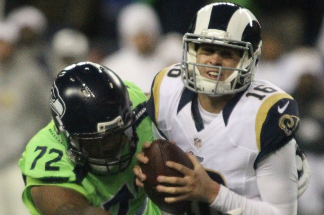 Los Angeles Rams quarterback Jared Goff (16) is sacked for a loss by Seattle  Seahawks defensive end Michael Bennett (72) at CenturyLink Field in Seattle 6046941f3
