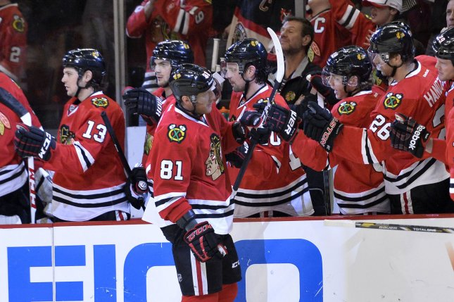 Chicago Blackhawks' Marian Hossa is congratulated by his teammates after scoring a goal during the first period against the Minnesota Wild. File photo by Brian Kersey/UPI
