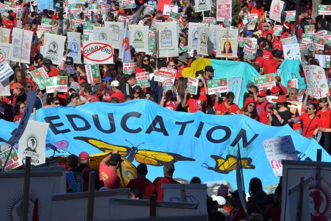 Thousands of Los Angeles Unified School District teachers and their supporters rally at City Hall and march through downtown to the Broad Museum Dec. 15. Photo by Jim Ruymen/UPI