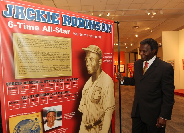 National Baseball Hall of Fame member Lou Brock getrs a closer look at the Jackie Robinson display at the Negro Leagues Baseball Museum in Kansas City on July 9, 2012. On October 23, 1945, Jackie Robinson, the first black baseball player hired by a major league team, was signed by the Brooklyn Dodgers and sent to their Montreal farm team. File Photo by Bill Greenblatt/UPI