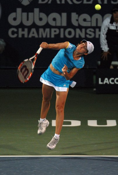 World number one, Justine Henin, from Belgium serves the ball to her opponent, Francesca Schiavone, from Italy, during the quarter finals of the Dubai Tennis Championships on Thursday February 28, 2008. Schiavone won the match 7-6 7-6. (UPI Photo/Norbert Schiller)