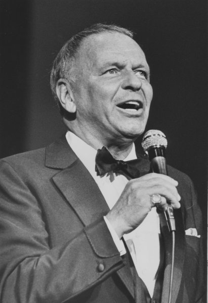 Francis Albert Sinatra would turn 100 on Dec. 12, 2015. Pictured: Sinatra brings a start-studded crowd to their feet as he sings New York, New York as only Old Blue Eyes can during the opening of the New Universal Amphitheatre in Los Angeles July 30, 1982. File photo by Glenn Waggner/UPI