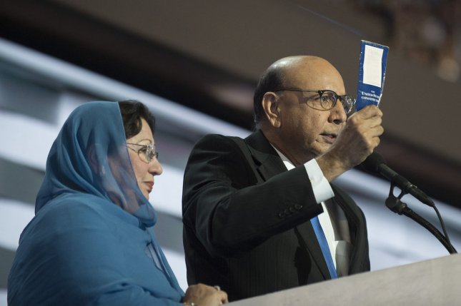 Khizr Khan holds a copy of the constitution alongside his wife imploring Republican presidential candidate Donald Trump to read it during Day Four of the Democratic National Convention at Wells Fargo Center in Philadelphia on Thursday. Khan's speech has generated high-profile responses, including from Trump, Indiana Gov. Mike Pence -- the GOP vice presidential candidate -- and Hillary Clinton. Arizona Sen. John McCain on Monday criticized Trump over his comments. Photo by Pete Marovich/UPI