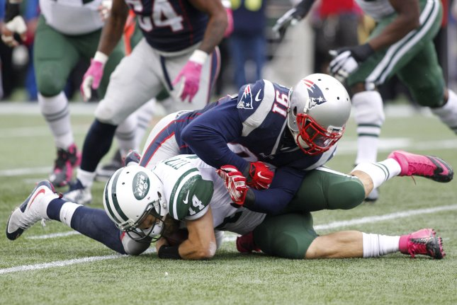 New York Jets quarterback Ryan Fitzpatrick (14) is sacked by New England Patriots linebacker Jamie Collins (91) in the second quarter at Gillette Stadium in Foxborough, Massachusetts on October 25, 2015. The Patriots defeated the Jets 30-23. Photo by Matthew Healey/ UPI