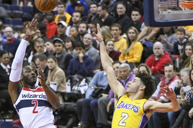 Washington Wizards guard John Wall (2) is fouled by Los Angeles Lakers guard Lonzo Ball (2) in the first half at Capital One Arena in Washington, D.C. on November 9, 2017. File photo by Mark Goldman/UPI
