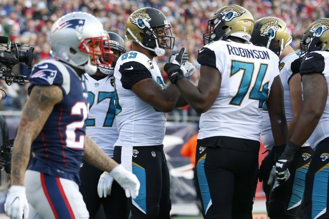Former Jacksonville Jaguars tight end Mercedes Lewis (89) and tackle Cam Robinson celebrate a touchdown against the New England Patriots in the second quarter of the AFC Championship game on January 21 at Gillette Stadium in Foxborough, Mass. Photo by Matthew Healey/UPI