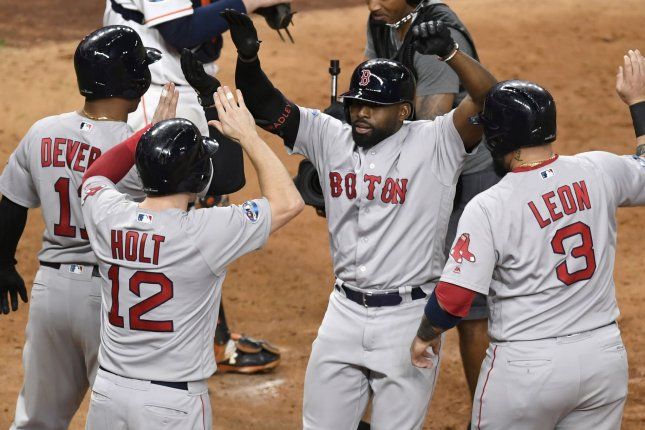 Boston Red Sox center fielder Jackie Bradley, Jr. (C) celebrates his grand slam home run against the Houston Astros with teammates Rafael Devers (L), Brock Holt (12), and Sandy Leon during the eighth inning of Game 3 of the American League Championship Series on Tuesday at Minute Maid Park in Houston. Photo by Trask Smith/UPI