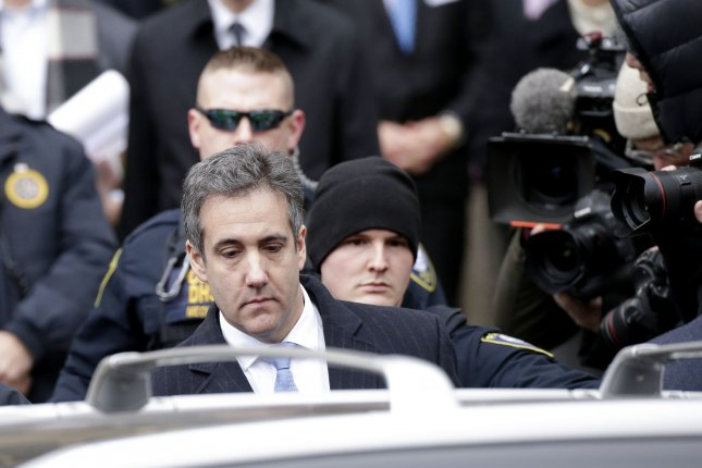 President Donald Trump's longtime personal lawyer Michael Cohen exits Manhattan Federal Court in New York City on December 12, 2018. Michael Cohen was sentenced Wednesday to three years in prison for crimes that included making illegal payoffs during the 2016 campaign to keep a porn star and a Playboy model silent about their alleged affairs with Donald Trump.Magazine publisher American Media inc. admitted its involvement in the hush money scheme on Wednesday. Photo by John Angelillo/UPI