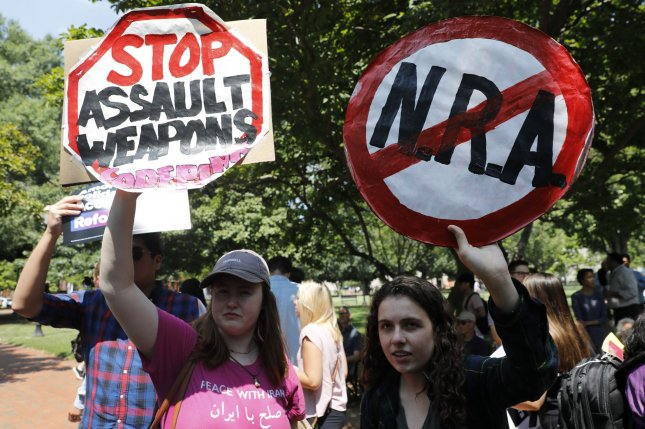 Demonstrators rally outside the White House Tuesday to urge changes in federal firearms laws, following two shooting attacks in Texas and Ohio. Photo by Yuri Gripas/UPI