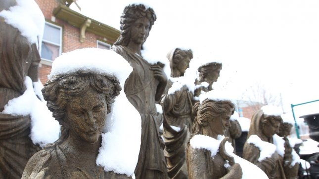 Statues still have remnants of snow on them on March 25, 2013, following a record snowfall dumped 12.4 inches on the St. Louis area on March 24, 2013. The National Weather Service said the amount that fell beat the one day record set in 1912. UPI/Bill Greenblatt