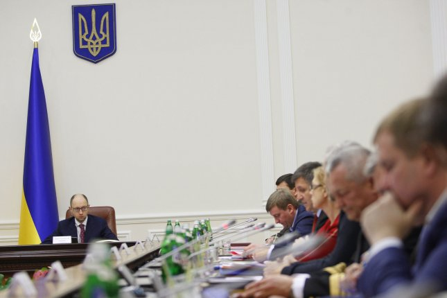 Ukrainian Prime Minister Arseniy Yatsenyuk holds a government meeting in Kiev on March 16, 2014. Ukraine signed a political pact with the 28-nation European Union Friday but delayed signing trade provisions in the association agreement. UPI/Ivan Vakolenko