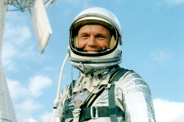 Astronaut John Glenn, wearing a pressure suit, poses as a pilot of the Mercury-Atlas 6 (MA-6) mission in 1962. The aviator, engineer and former U.S. senator died Thursday in Columbus, Ohio, at the age of 95. UPI Photo/File