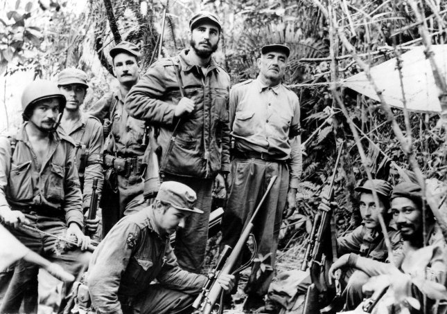 Fidel Castro, leader of Cuba's revolutionary forces, and members of his staff are pictured in the Sierra Maestra mountains on June 7, 1957. UPI File Photo